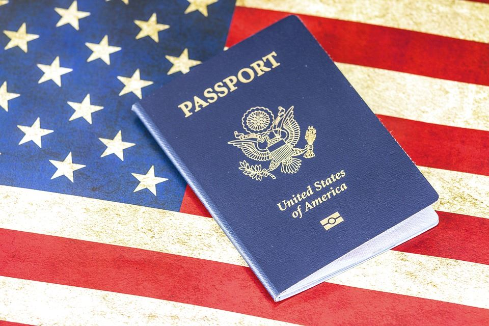 Photo of a US passport on an American flag