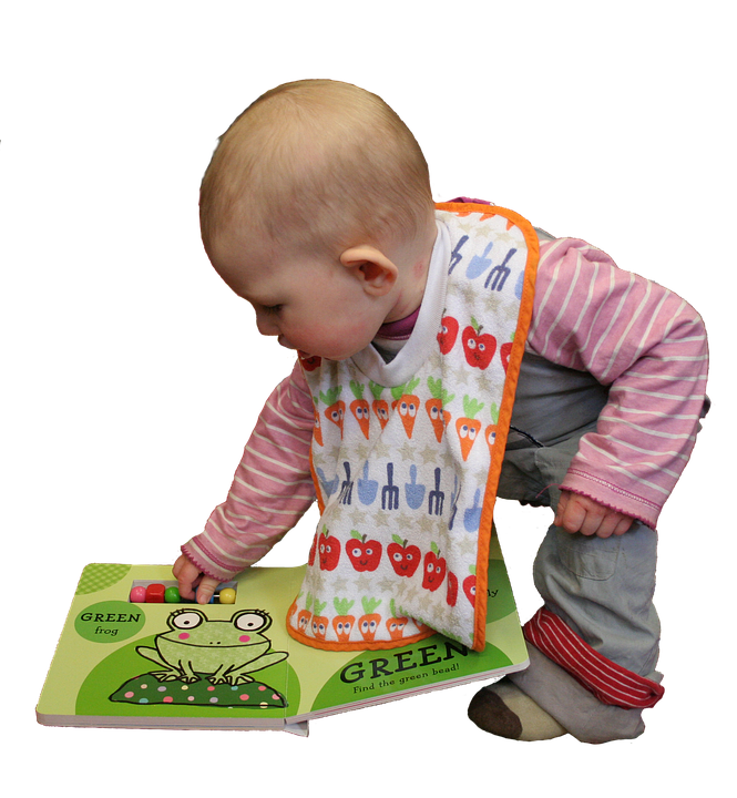 Photograph of a waddler picking-up a book