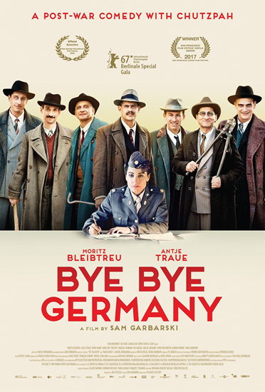 Cover image for movie Bye Bye Germany showing seated woman holding pen with eight men standing behin
