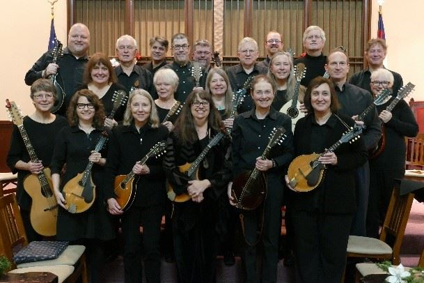 Seattle Mandolin Orchestra: group of men and women dressed in black all holding mandolins of various