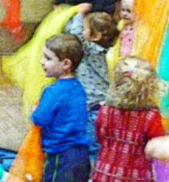Image of 3 children playing with colorful scaves