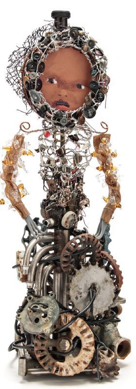 Photo of artwork by Marita Dingus of a tall figure sculpture made of wire, machinery, and other foun