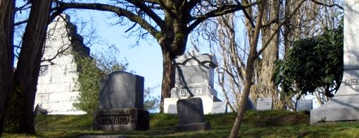 Photo of the Rucker Mausoleum and nearby gravestones.